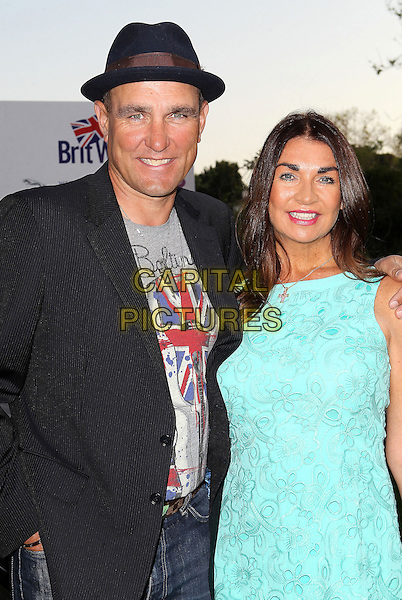 "Vinnie Jones & Tanya Jones.7th Annual BritWeek Festival ""A Salute To Old Hollywood"" Launch Party held at the British Consul General's Residence, Los Angeles, California, USA..April 23rd, 2013.half length black suit hat grey gray union jacket print blue turquoise sleeveless dress  married husband wife .CAP/ADM/KB.©Kevan Brooks/AdMedia/Capital Pictures"