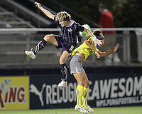 Sonia Bompastor #8 of the Washington Freedom heads the ball backwards over Estelle Johnson #24 of the Philadelphia Independence during a WPS match on August 4 2010 at the Maryland Soccerplex, in Boyds, Maryland.Freedom won 2-0.