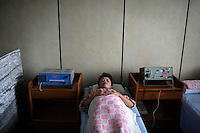 A patient lies in bed in the Pyongyang Maternity Hospital in Pyongyang, North Korea (DPRK) on 21 August 2007.