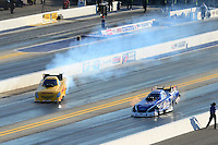 Apr. 13, 2012; Concord, NC, USA: NHRA funny car driver Jeff Arend (left) gets sideways alongside Robert Hight during qualifying for the Four Wide Nationals at zMax Dragway. Mandatory Credit: Mark J. Rebilas-
