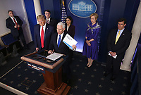 United States Vice President Mike Pence delivers remarks on the COVID-19 (Coronavirus) pandemic alongside President Donald Trump and members of the Coronavirus Task Force in the Brady Press Briefing Room at the White House in Washington, DC, March 18, 2020, in Washington, D.C. Left to right, front row: United States President Donald J. Trump, Vice President Pence.  Back row, left to right: US Secretary of Veterans Affairs (VA) Robert Wilkie, Seema Verma, Administrator, Centers for Medicare and Medicaid Services, Dr. Deborah L. Birx, White House Coronavirus Response Coordinator and US Secretary of Defense Dr. Mark T. Esper.<br /> Credit: Kevin Dietsch / Pool via CNP/AdMedia