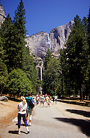 People walking towards Yosemite Falls in Yosemite National Park, California, USA