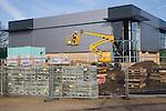 Cherry picker crane at construction site, UK