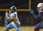Lawndale, CA 10/14/16 - Malik Welch (North Torrance #1) and Danthony Jones (Leuzinger #4) in action during the North Torrance vs Leuzinger CIF League football game.