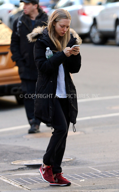 WWW.ACEPIXS.COM<br /> <br /> March 22 2015, New York City<br /> <br /> Actress Amanda Seyfried walks and texts in the East Village on March 22 2015 in New York City<br /> <br /> By Line: Zelig Shaul/ACE Pictures<br /> <br /> <br /> ACE Pictures, Inc.<br /> tel: 646 769 0430<br /> Email: info@acepixs.com<br /> www.acepixs.com