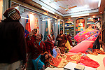 Female customers in a silk shop in Varanasi old town. Varanasi. India