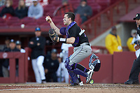 Holy Cross Crusaders catcher Riley Livingston (23) grabs the ball out in front of home plate during the game against the South Carolina Gamecocks at Founders Park on February 15, 2020 in Columbia, South Carolina. The Gamecocks defeated the Crusaders 9-4.  (Brian Westerholt/Four Seam Images)