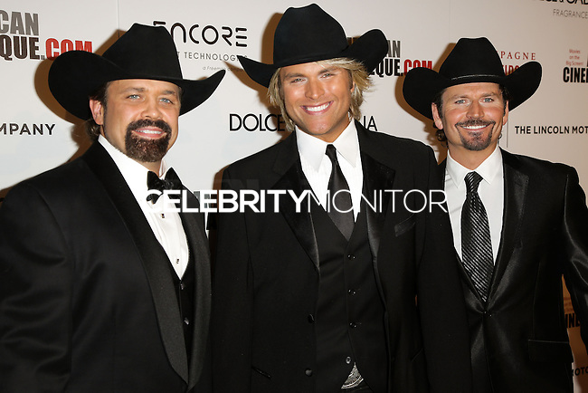 BEVERLY HILLS, CA, USA - OCTOBER 21: John Hagen, Marcus Collins, JC Fisher arrive at the 28th American Cinematheque Award Honoring Matthew McConaughey held at The Beverly Hilton Hotel on October 21, 2014 in Beverly Hills, California, United States. (Photo by Celebrity Monitor)
