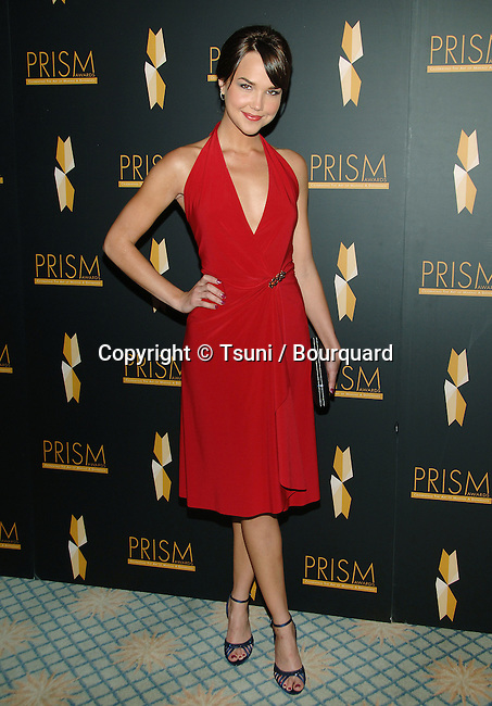 Arielle Kebbel  arriving at the PRISM AWARDS 2007 at the Beverly Hills Hotel in Los Angeles.<br /> <br /> full length<br /> eye contact<br /> red dress