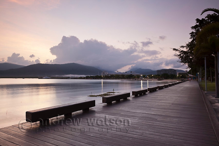 View along the Esplanade boardwalk at twilight.  Cairns, Queensland, Australia