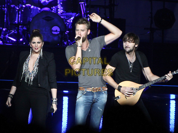 Hillary Scott, Charles Kelley, Dave Haywood of Lady Antebellum.Country stars Lady Antebellum made a stop on their tour in Duluth, GA, at the Gwinnett Center Arena, .June 22nd, 2012..music country concert gig onstage performing live half length black grey gray t-shirt playing guitar  microphone singing .CAP/ADM/DH.©Dan Harr/AdMedia/Capital Pictures.