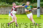 Tomas O Caomhanaigh Lispole and mikey Houlihan Cromane in action during their Novice Championship semi final in Keel on Saturday