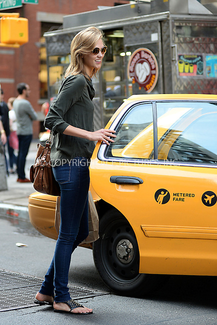 WWW.ACEPIXS.COM<br /> June 11, 2014 New York City<br /> <br /> Karlie Kloss in SoHo in New York City on June 11, 2014.<br /> <br /> By Line: Kristin Callahan/ACE Pictures<br /> ACE Pictures, Inc.<br /> tel: 646 769 0430<br /> Email: info@acepixs.com<br /> www.acepixs.com