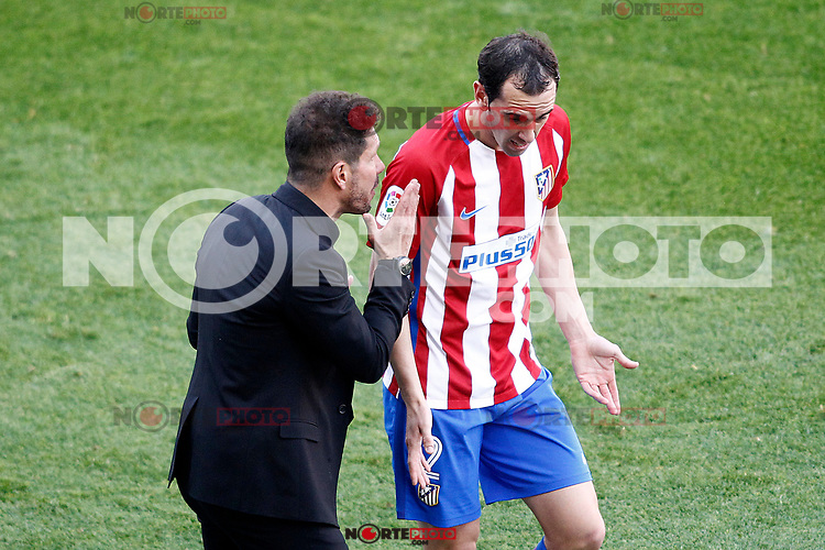 Atletico de Madrid's coach Diego Pablo Cholo Simeone (l) with Diego Godin during La Liga match. March 19,2017. (ALTERPHOTOS/Acero) /NORTEPHOTO.COM