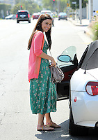 Jessica Lowndes throws her beautiful smile to the photographers while running errands in a green tulip print dress with peach cardigan. Los Angeles, California on 22.07.2012..Credit: Correa/face to face.. / Mediapunchinc ***online only for weekly magazines**** /NortePhoto.com*<br />