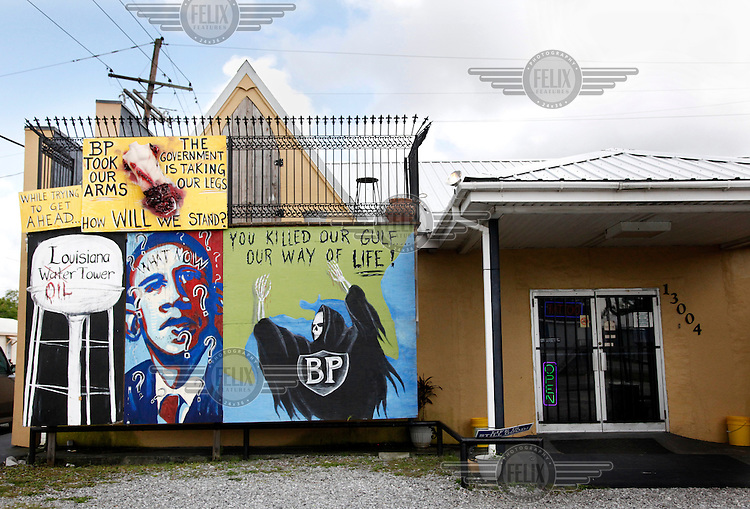Murals on the front of the Southern Sting Tatoo parlor on route 1, the road that leads to Venice, Louisiana. The murals on the shop's exterior depict the frustration the owner feels about the response to the BP Deep Water Horizon oil spill.
