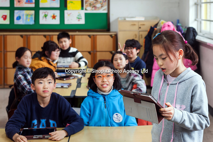 Jawoon Elementary School, Seould, South Korea.  The children use high tech teaching methods including the use of ipads.
