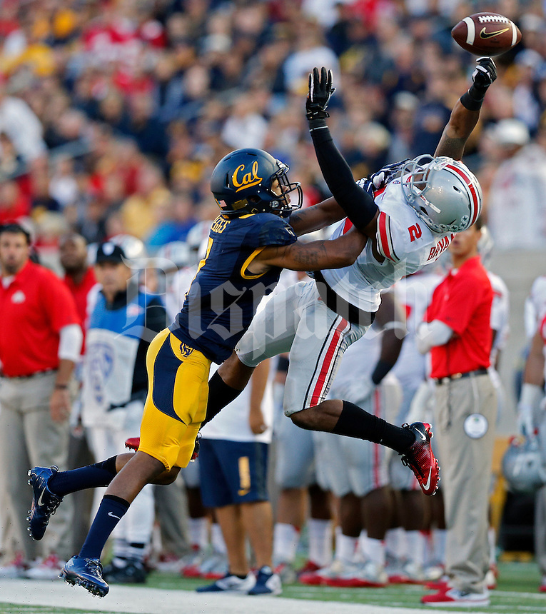 Ohio State Buckeyes safety Christian Bryant (2) knocks the ball away from California Golden Bears wide receiver Bryce Treggs (1) in 3rd quarter at Memorial Stadium in Berkeley, California on September 14, 2013.  (Dispatch photo by Kyle Robertson)