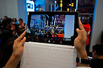 A man takes pictures with his new Microsoft tablet surface during the opening of Microsoft's store at Times Square in New York, October 25, 2012. . Photo by Eduardo Munoz Alvarez / VIEW.