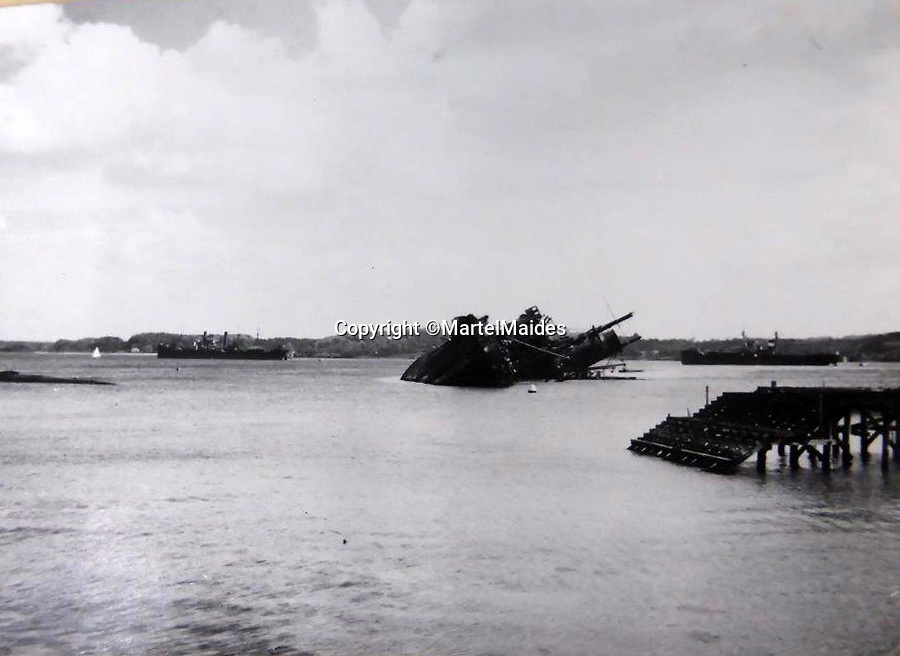 BNPS.co.uk (01202 558833)<br /> Pic: MartelMaides/BNPS<br /> <br /> Sunken ships still remained in Kiel harbour in 1946 - Although the town was beyond the stop-line set for the western Allies after the German surrender at Lüneburg Heath, its port, its scientists, and the canal were seized by a British T-Force led by Major Tony Hibbert on 5 May 1945.<br /> <br /> A fascinating archive of photos that offer an insight into what postwar Germany was like just after the end of WW2 has come to light.<br /> <br /> The incredible album of 262 black and white pictures show the stark aftermath of the war - buildings reduced to rubble in the capital Berlin, a flooded town and an abandoned factory where the Germans made their deadly V-2 rockets.<br /> <br /> They are believed to have been taken by a British soldier who was with Allied forces administrating the war ravaged country a year after the end of hostilities.<br /> <br /> The archive is being sold by Martel Maides on Guernsey on June 9.