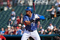 Frisco RoughRiders Ronald Guzman (11) bats during a Texas League game against the Springfield Cardinals on May 5, 2019 at Dr Pepper Ballpark in Frisco, Texas.  (Mike Augustin/Four Seam Images)