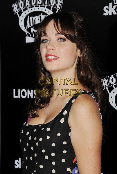 HOLLYWOOD, CA- SEPTEMBER 10: Actress Zooey Deschanel attends 'The Skeleton Twins' Los Angeles premiere held at the ArcLight Hollywood on September 10, 2014 in Hollywood, California.<br /> CAP/ROT/TM<br /> &copy;Tony Michaels/Roth Stock/Capital Pictures