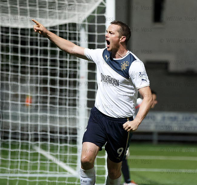 Jon Daly heads in the second goal for Rangers and celebrates to the away fans