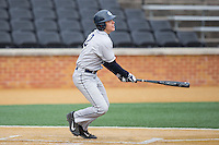 Chase Bushor (2) of the Georgetown Hoyas follows through on his swing against the Bucknell Bison at Wake Forest Baseball Park on February 14, 2015 in Winston-Salem, North Carolina.  The Hoyas defeated the Bison 8-5.  (Brian Westerholt/Four Seam Images)