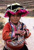 Pisac, Peru. Young Quechua girl wearing traditional dress.