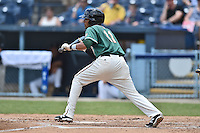 Greensboro Grasshoppers shortstop Rehiner Cordova #11 squares to bunt during a game against the  Asheville Tourists at McCormick Field June 29, 2014 in Asheville, North Carolina. The Grasshoppers defeated the Tourists 4-0. (Tony Farlow/Four Seam Images)
