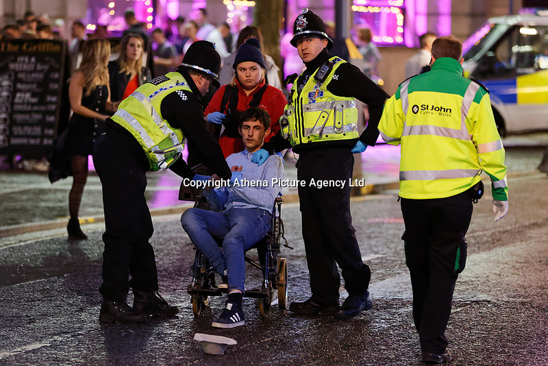 Police officers speak with a young man in Wind Street, Swansea, Wales  on Mad Friday, Booze Black Friday or Black Eye Friday, the last Friday night before Christmas Day, when traditionally people in the UK go out to celebrate the start of their holidays. Friday 22 December 2017