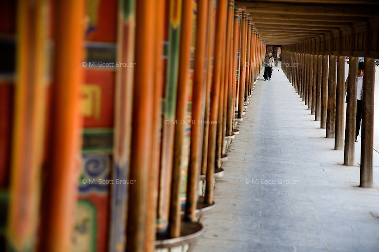 Prayer wheels surround the Labrang Monastery in Xiahe, Gansu, China.  Xiahe, home of the Labrang Monastery, is an important site for Tibetan Buddhists.  The population of the town is divided between ethnic Tibetans, Muslims, and Han Chinese.