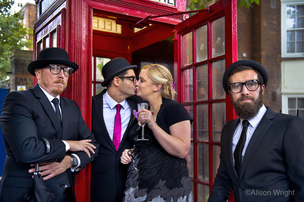 Couple and their wedding party, married at town Hall, Islington. 2010