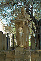 Statue representing either King Ferdinand the Saint or Alfonso X the Wise, in the gardens of the Alcazar de Cordoba, Cordoba, Andalusia, Spain.