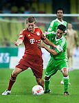 Toni Kroos of Bayern Munich and Josue of VfL Wolfsburg in action during a friendly match as part of the Audi Football Summit 2012 on July 26, 2012 at the Guangdong Olympic Sports Center in Guangzhou, China. Photo by Victor Fraile / The Power of Sport Images