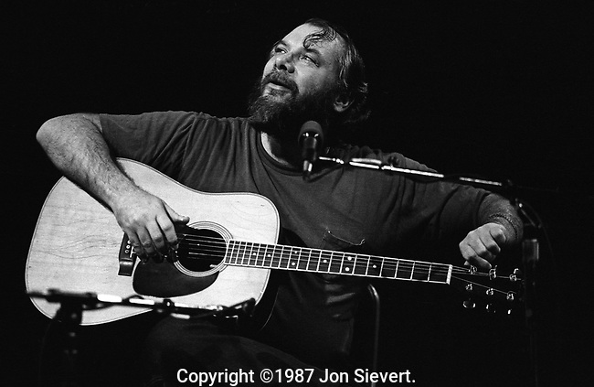 John Fahey, Dec 1982. An American fingerstyle guitarist and composer who pioneered the steel-string guitar as a solo instrument. His style has been greatly influential and has been described as the foundation of American Primitivism, a term borrowed from painting and referring mainly to the self-taught nature of the music and its minimalist style. Fahey borrowed from the folk and blues traditions in American roots music, having compiled many forgotten early recordings of music in these genres himself.