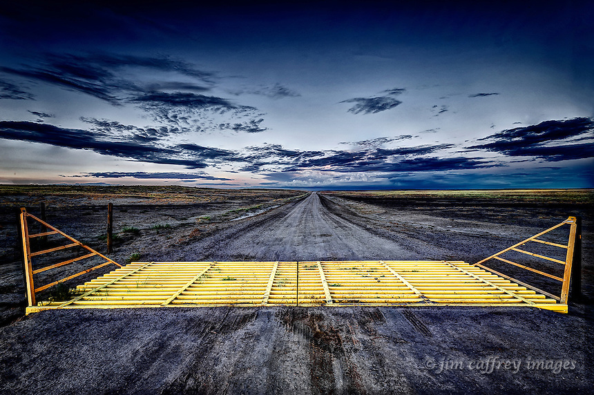 A cattle guard on a county road in the San Juan Basin in northwest New Mexico just after sunset.