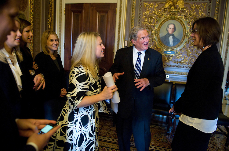 UNITED STATES - DECEMBER 14:  Sen. Kit Bond, R-Mo., talks with his staffers Anne Ekern, right, and Shana Marchio, in the Senate Reception after a group photo with his staff.  Earlier, Bond delivered his farewell address on the Senate floor because of his retirement.  (Photo By Tom Williams/Roll Call)