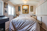 BNPS.co.uk (01202 558833)<br /> Pic: PurpleBricks/BNPS<br /> <br /> Sleeper car...<br /> <br /> This £475,000 seaside cottage contains a charming secret – it's built around two Victorian railway carriages.<br /> <br /> The 19th century carriages were used as temporary housing for soldiers returning from the First World War when there was a shortage of homes.<br /> <br /> But many of them remained in place years later and had bricks and mortar built around them.<br /> <br /> And so from the street view they looked like normal houses but inside the main reception rooms were with the converted carriages.