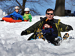 (Boston, Ma 030913)   Rob Whitney of Boston, seemingly having more fun than his 5 year-old son Adam, as they sled together, Saturday, March 9, on the Boston Common. (Jim Michaud /Photo) For Sunday