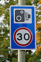 Warning signs for speed cameras ahead.