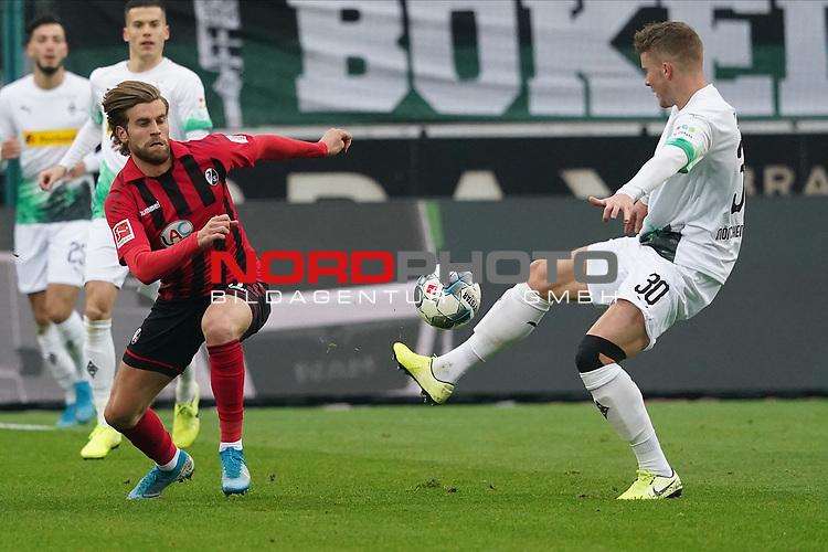 01.12.2019, Borussia Park , Moenchengladbach, GER, 1. FBL,  Borussia Moenchengladbach vs. SC Freiburg,<br />  <br /> DFL regulations prohibit any use of photographs as image sequences and/or quasi-video<br /> <br /> im Bild / picture shows: <br /> Lucas Höler / Hoeler (Freiburg #9), im Zweikampf gegen  Nico Elvedi (Gladbach #30),  <br /> <br /> Foto © nordphoto / Meuter