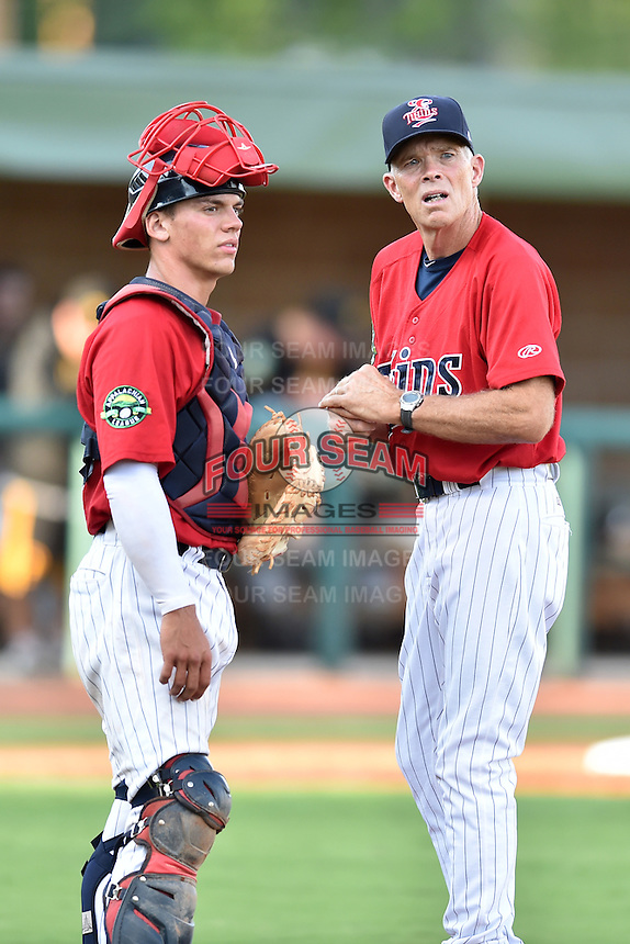 Elizabethton Twins catcher Ben Rortvedt (33) and manager Ray Smith (2) discuss the pitching change during a game against the Bristol Pirates at Joe O'Brien Field on July 30, 2016 in Elizabethton, Tennessee. The Twins defeated the Pirates 6-3. (Tony Farlow/Four Seam Images)
