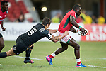 Trael Joass of New Zealand (left) tries to tackle Bush Mwale of Kenya who runs with the ball during the match New Zealand vs Kenya, Day 2 of the HSBC Singapore Rugby Sevens as part of the World Rugby HSBC World Rugby Sevens Series 2016-17 at the National Stadium on 16 April 2017 in Singapore. Photo by Victor Fraile / Power Sport Images