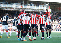 8th February 2020; Griffin Park, London, England; English Championship Football, Brentford FC versus Middlesbrough; Julian Jeanvier of Brentford celebrates with his team mates after scoring his sides 1st goal in the 24th minute to make it 1-0