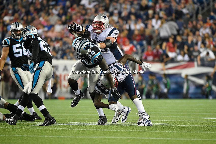 August 22, 2014 - Foxborough, Massachusetts, U.S.- New England Patriots guard Logan Mankins (70) and wide receiver Kenbrell Thompkins (85) team up to disrupt Carolina Panthers outside linebacker Thomas Davis (58) during the NFL pre-season game between the New England Patriots and the Carolina Panthers held at Gillette Stadium in Foxborough Massachusetts. The Patriots defeated the Panthers 30-7 in regulation time. Eric Canha/CSM