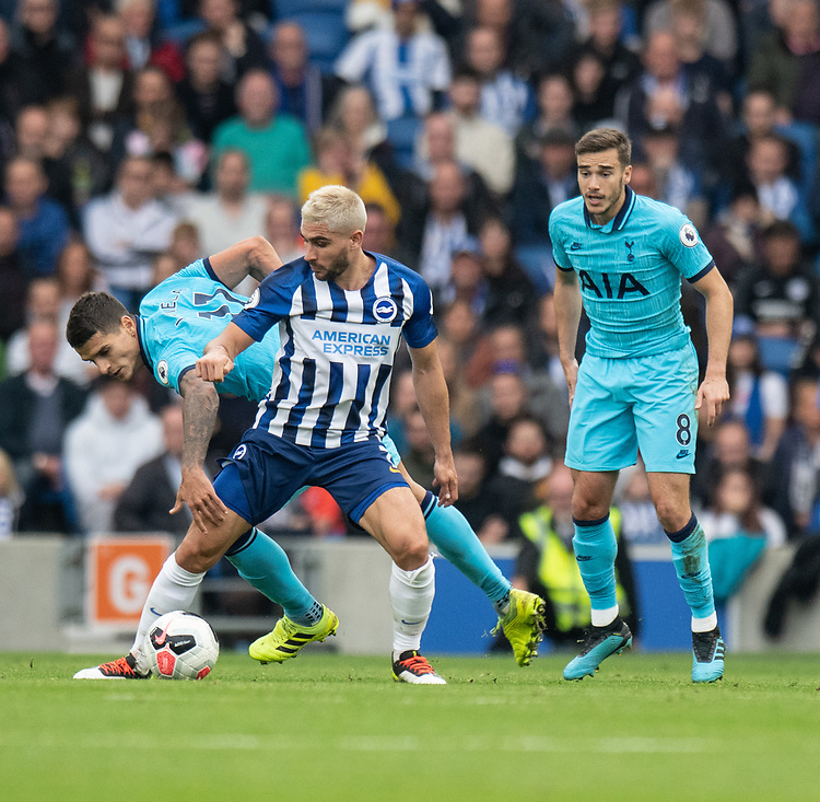 Brighton & Hove Albion's Neal Maupay (right) is tackled by Tottenham Hotspur's Erik Lamela (left) <br /> <br /> Photographer David Horton/CameraSport<br /> <br /> The Premier League - Brighton and Hove Albion v Tottenham Hotspur - Saturday 5th October 2019 - The Amex Stadium - Brighton<br /> <br /> World Copyright © 2019 CameraSport. All rights reserved. 43 Linden Ave. Countesthorpe. Leicester. England. LE8 5PG - Tel: +44 (0) 116 277 4147 - admin@camerasport.com - www.camerasport.com