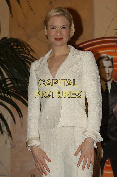 RENEE ZELLWEGER.3 December 2003.white jacket, half length, half-length.www.capitalpictures.com.sales@capitalpictures.com.© Capital Pictures