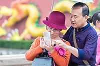 Nanjing, Jiangsu, China.  Middle-aged Chinese Couple Taking a Photo.