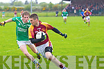 Peter Shearan of Duagh side steps Ballyduffs Padraig Boyle last Saturday in Duagh.